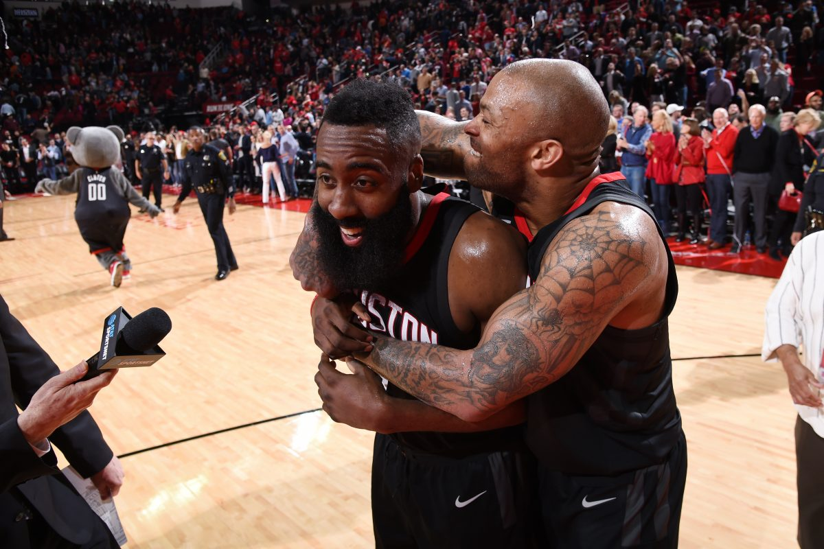 HOUSTON, TX - JANUARY 30: James Harden #13 and PJ Tucker #4 of the Houston Rockets celebrate a win against the Orlando Magic on January 30, 2018 at the Toyota Center in Houston, Texas. James Harden is the first player in Rockets history to score 60 points in a game, and he's the first player in NBA history to produce 60+ points and 10+ assists in the same game. James Harden has also become the first player in NBA history to record a triple-double with at least 60 points scored. NOTE TO USER: User expressly acknowledges and agrees that, by downloading and or using this photograph, User is consenting to the terms and conditions of the Getty Images License Agreement. Mandatory Copyright Notice: Copyright 2018 NBAE   Bill Baptist/NBAE via Getty Images/AFP