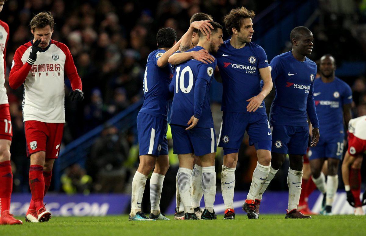 """SD01. LONDRES (R.UNIDO), 12/02/2018.- Eden Hazard (c) de Chelsea celebra un gol hoy, lunes 12 de febrero de 2018, durante un partido de la Premier League entre Chelsea y West Bromwich Albion en el estadio Stamford Bridge en Londres (R.Unido). EFE/SEAN DEMPSEY SOLO USO EDITORIAL/ Uso no autorizado en audios, vídeos, informaciones, listados de equipos o logotipos o servicios """"en vivo"""". Uso en línea limitado a 75 imágenes, no usar en simulaciones de vídeo. No usar en apuestas, juegos o publicaciones independientes de equipos, jugadores o ligas."""