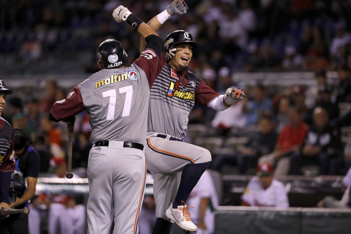 Rafael Ortega Caribes de Anzoategui of Venezuela celebrates after scoring against Tomateros de Culiacan of Mexico during the Caribbean Baseball Series at the Charros Jalisco stadium in Guadalajara, Jalisco state, Mexico, on February 4, 2018. / AFP PHOTO / ULISES RUIZ