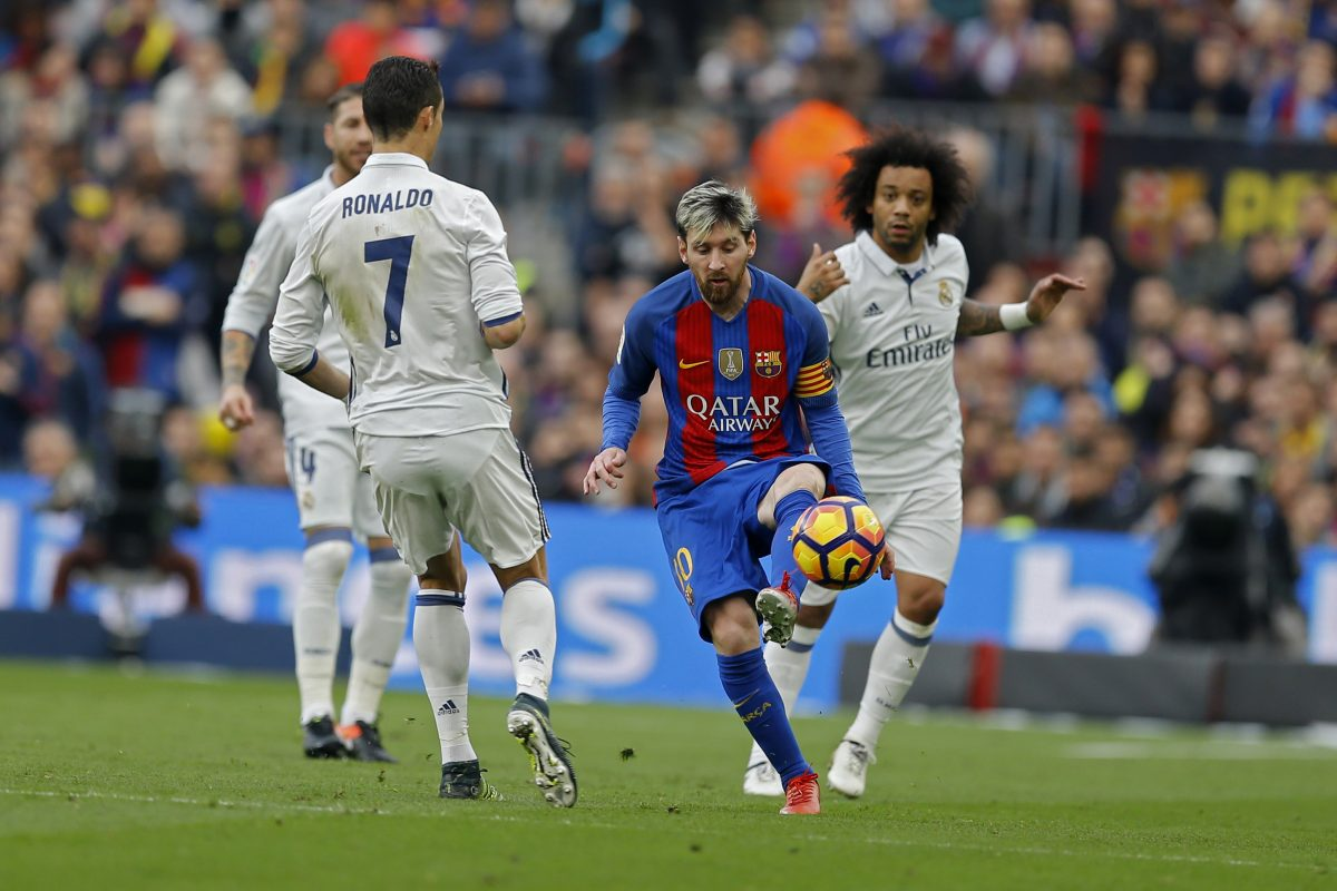 Barcelona's Lionel Messi, centre, vies for the ball with Real Madrid's Cristiano Ronaldo, left, and Marcelo, right, during the Spanish La Liga soccer match between FC Barcelona and Real Madrid at the Camp Nou in Barcelona, Spain, Saturday, Dec. 3, 2016. (AP Photo/Francisco Seco)