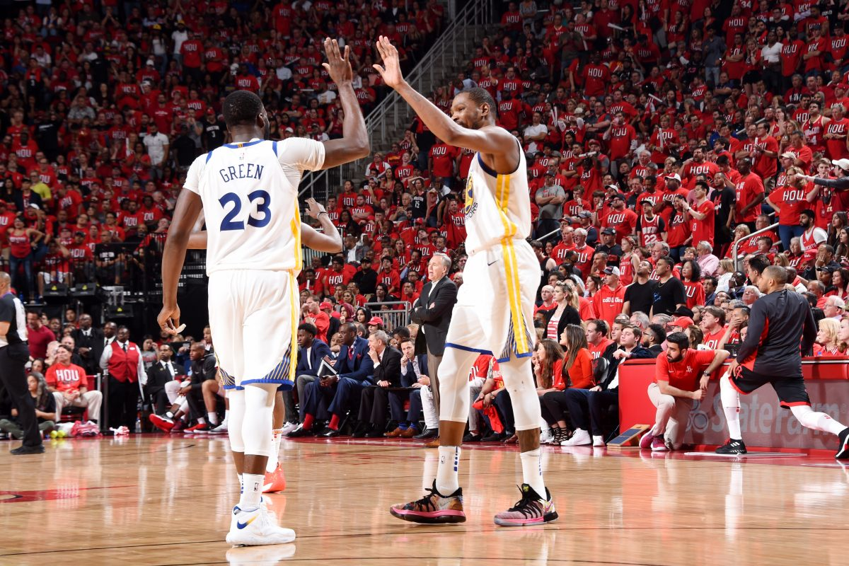 HOUSTON, TX - MAY 14: Draymond Green #23 and Kevin Durant #35 of the Golden State Warriors exchange a high five during Game One of the Western Conference Finals of the 2018 NBA Playoffs on May 14, 2018 at the Toyota Center in Houston, Texas. NOTE TO USER: User expressly acknowledges and agrees that, by downloading and or using this photograph, User is consenting to the terms and conditions of the Getty Images License Agreement. Mandatory Copyright Notice: Copyright 2018 NBAE   Andrew D. Bernstein/NBAE via Getty Images/AFP