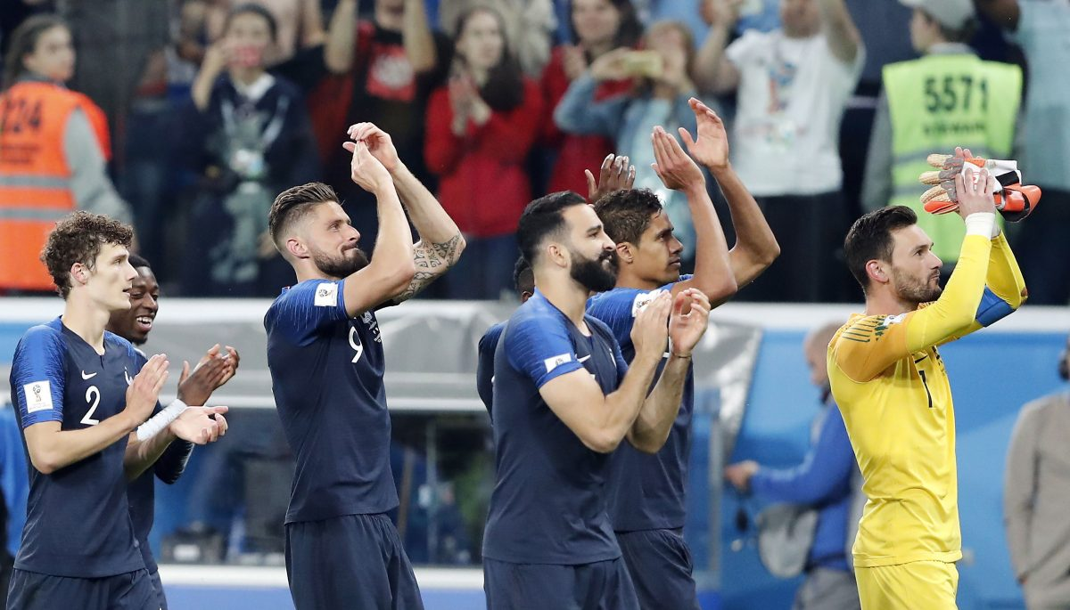 St.petersburg (Russian Federation), 10/07/2018.- Benjamin Pavard of France (L), Olivier Giroud of France (2L), Raphael Varane of France (2R) and Goalkeeper Hugo Lloris of France (R) react after winning the FIFA World Cup 2018 semi final soccer match between France and Belgium in St.Petersburg, Russia, 10 July 2018.  (RESTRICTIONS APPLY: Editorial Use Only, not used in association with any commercial entity - Images must not be used in any form of alert service or push service of any kind including via mobile alert services, downloads to mobile devices or MMS messaging - Images must appear as still images and must not emulate match action video footage - No alteration is made to, and no text or image is superimposed over, any published image which: (a) intentionally obscures or removes a sponsor identification image; or (b) adds or overlays the commercial identification of any third party which is not officially associated with the FIFA World Cup) (Mundial de Fútbol, Bélgica, Rusia, Francia) EFE/EPA/ANATOLY MALTSEV EDITORIAL USE ONLY