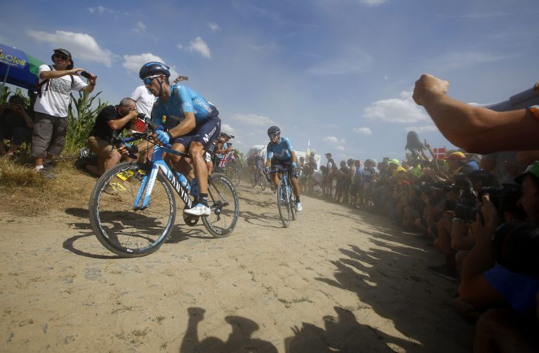 Roubaix (France), 15/07/2018.- Movistar team rider Imanol Erviti (L) of Spain and Movistar team rider Mikel Landa (R) of Spain in action through a cobblestone section during the 9th stage of the 105th edition of the Tour de France cycling race over 156,5km between Arras and Roubaix, France, 15 July 2018. Richie Porte retires from the race. (España, Ciclismo, Francia) EFE/EPA/KIM LUDBROOK