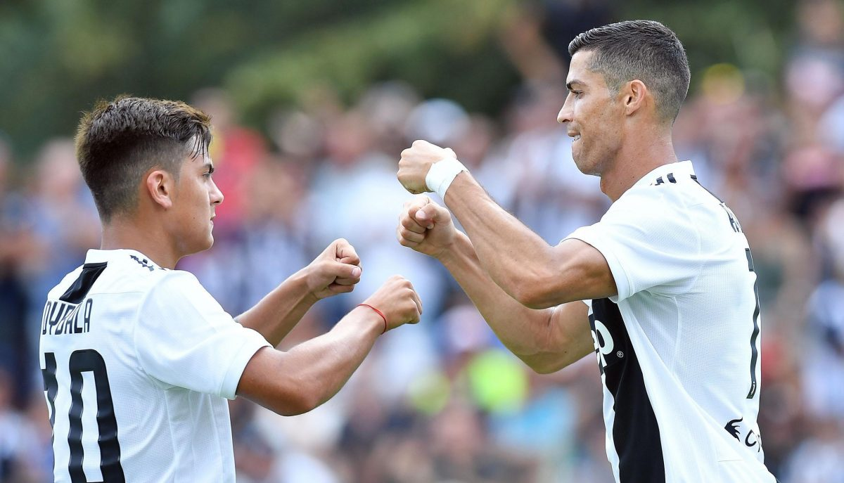 Turin (Italy), 12/08/2018.- Juventus' Cristiano Ronaldo (R) celebrates with teammate Paulo Dybala during a soccer friendly match between Juvents A and Juventus B at Villar Perosa, Turin, 12 August 2018. (Futbol, Amistoso, Italia) EFE/EPA/ALESSANDRO DI MARCO