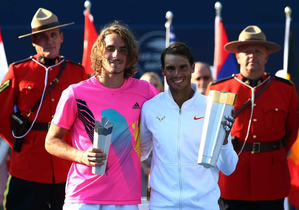 TORONTO, ON - AUGUST 12: Rafael Nadal (R) of Spain with the champions trophy following his win in the final match against Stefanos Tsitsipas (L) of Greece on Day 7 of the Rogers Cup at Aviva Centre on August 12, 2018 in Toronto, Canada.   Vaughn Ridley/Getty Images/AFP