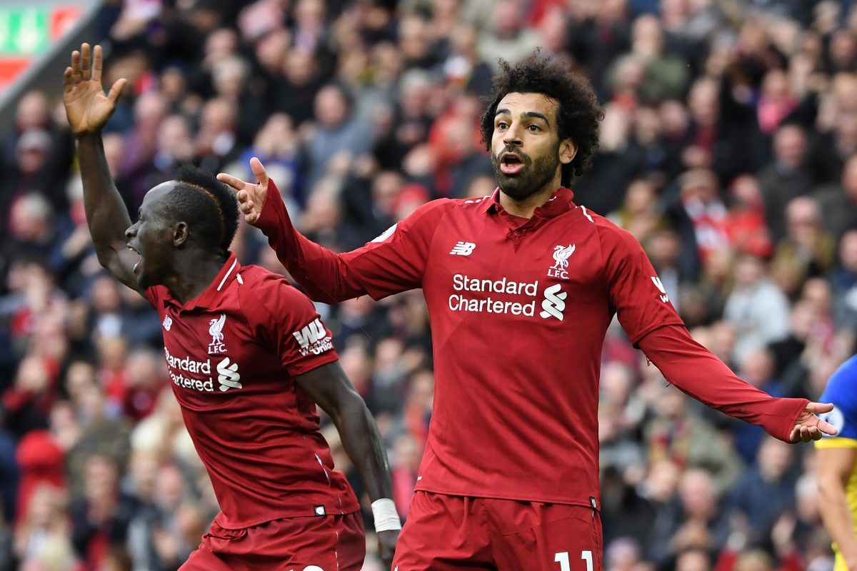 Liverpool's Senegalese striker Sadio Mane (L) and Liverpool's Egyptian midfielder Mohamed Salah gesture during the English Premier League football match between Liverpool and Southampton at Anfield in Liverpool, north west England on September 22, 2018. / AFP PHOTO / Paul ELLIS / RESTRICTED TO EDITORIAL USE. No use with unauthorized audio, video, data, fixture lists, club/league logos or 'live' services. Online in-match use limited to 120 images. An additional 40 images may be used in extra time. No video emulation. Social media in-match use limited to 120 images. An additional 40 images may be used in extra time. No use in betting publications, games or single club/league/player publications. /