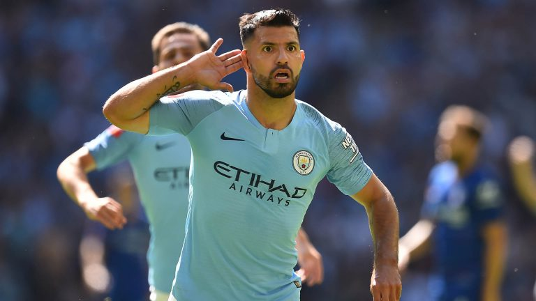 Manchester City's Argentinian striker Sergio Aguero celebrates after scoring the opening goal of the English FA Community Shield football match between Chelsea and Manchester City at Wembley Stadium in north London on August 5, 2018. / AFP PHOTO / Glyn KIRK / NOT FOR MARKETING OR ADVERTISING USE / RESTRICTED TO EDITORIAL USE