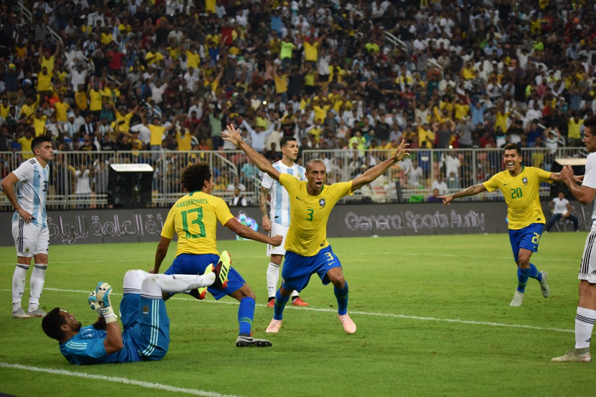 Brazil's defender Miranda (C) celebrates after scoring a goal during the international friendly match Brazil vs Argentina at the King Abdullah Sport City Stadium in Jeddah on October 16, 2018.  AFP (Photo by STR / AFP)