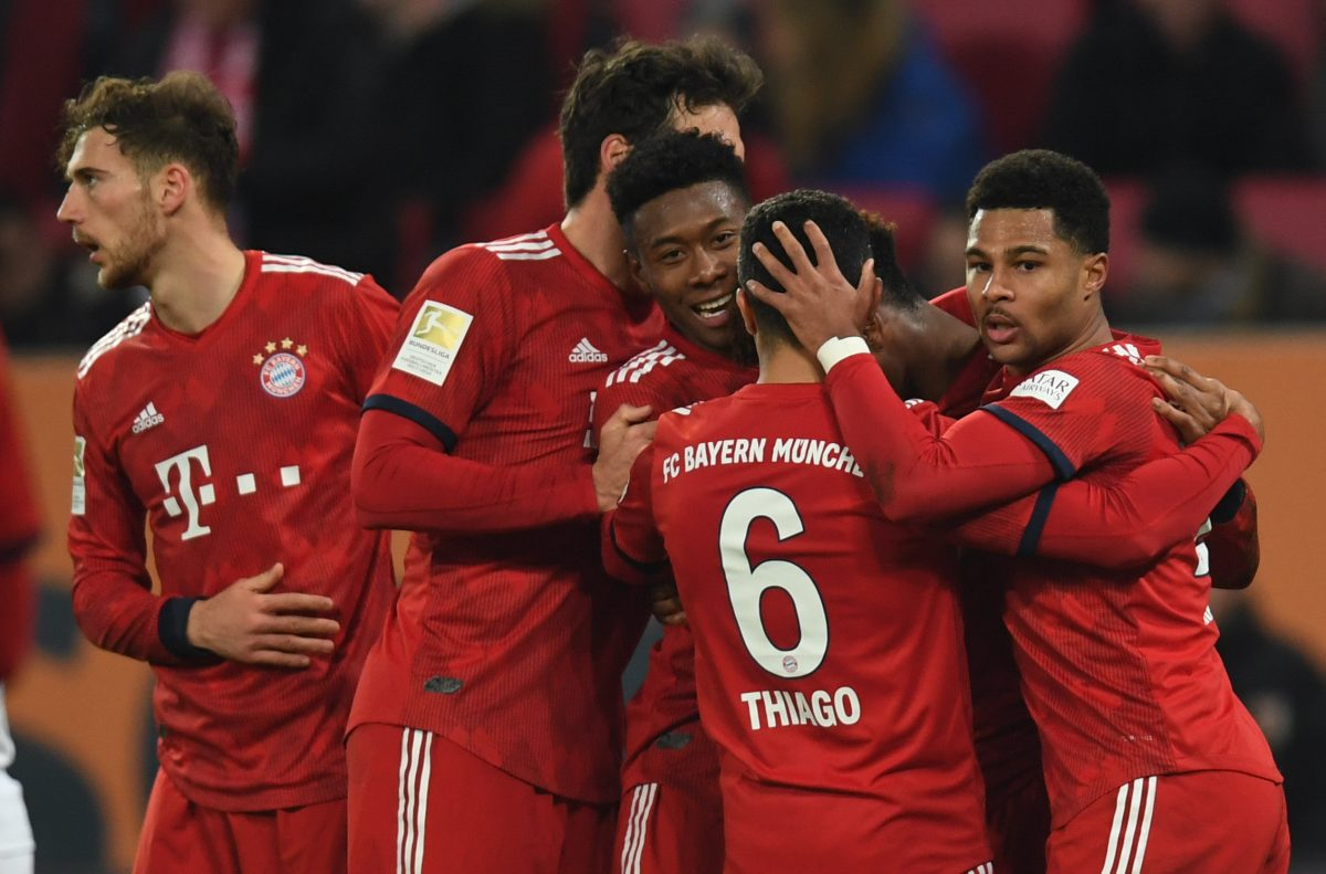 (L-R) Bayern Munich's midfielder Leon Goretzka, Bayern Munich's defender Mats Hummels, Bayern Munich's Austrian defender David Alaba, Bayern Munich's Spanish midfielder Thiago Alcantara, Bayern Munich's French defender Kingsley Coman and Bayern Munich's midfielder Serge Gnabry react after the second goal for Munich during the German first division Bundesliga match between FC Augsburg and FC Bayern Munich in Augsburg, southern Germany, on February 15, 2019. (Photo by Christof STACHE / AFP) / DFL REGULATIONS PROHIBIT ANY USE OF PHOTOGRAPHS AS IMAGE SEQUENCES AND/OR QUASI-VIDEO